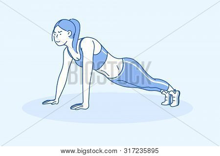 Sport Concept Of A Young Beautiful Sport Woman Doing Plank. Strong Athletic Girl Performs Pushups Or