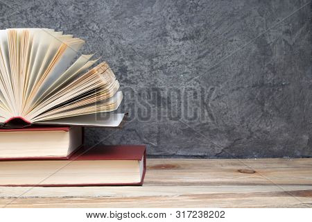 Open Book, Books On The Gray Concrete Background. Back To School. Education. Copy Space For Text.