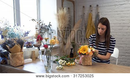 Young Woman Working In Flower Shop..