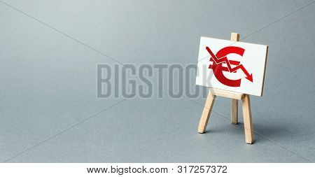 A Easel With A Canvas And A Red Euro Arrow Down. National Currency Decline, Devaluation And Inflatio