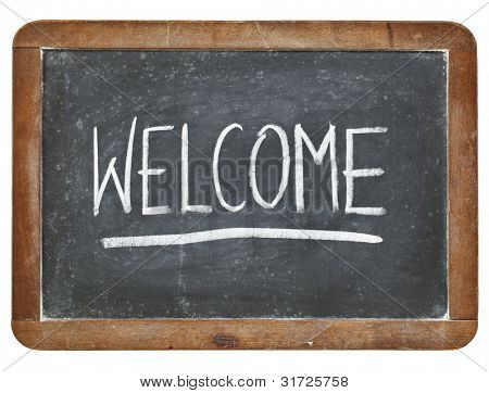 welcome -  hospitality concept - white chalk handwriting on isolated vintage slate blackboard poster