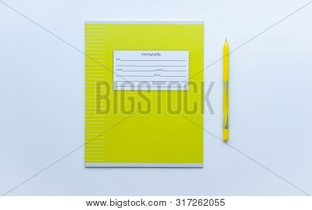 Top View Of Front Page Of Green Pupils Copybook With Form To Sign In: Name, Surname, Grade, Etc. Wit