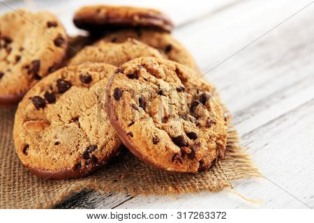 Chocolate Cookies On Wooden Table. Chocolate Chip Cookies Shot On Wooden White Table