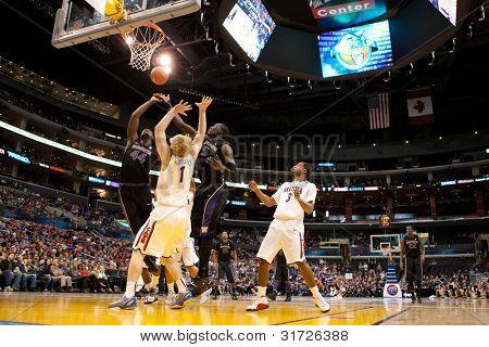 LOS ANGELES - MARCH 12: Arizona Wildcats C Kyryl Natyazhko #1 (C) Washington Huskies F Darnell Gant #44 (L) & Huskies C Aziz N'Diaye #5 (R) during the NCAA Pac-10 Tournament game on March 12 2011
