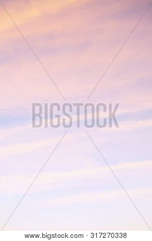 Pink dramatic sunset sky background - picturesque colorful clouds lit by sky sunlight. Vast sky landscape panoramic scene in soft pastel tones. Sky colorful landscape, sky nature scene