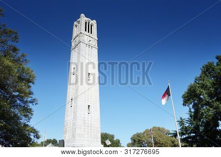 The Belltower On The Campus Of Nc State University In Raleigh North Carolina With The State Flag