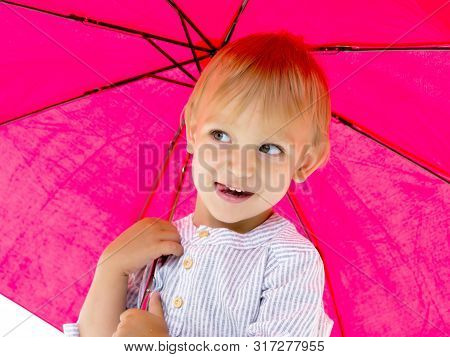 A Cute Little Boy Took Refuge Under An Umbrella. Concept Game, Happy Childhood. Isolated On White Ba