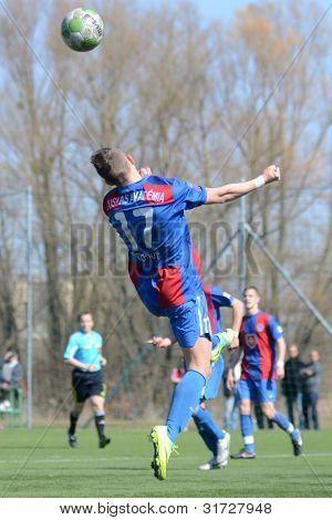 KAPOSVAR, HUNGARY - MARCH 17: Adam Menyhert (17) in action at the Hungarian National Championship under 18 game between Kaposvar (white) and Videoton (blue), March 17, 2012 in Kaposvar, Hungary.