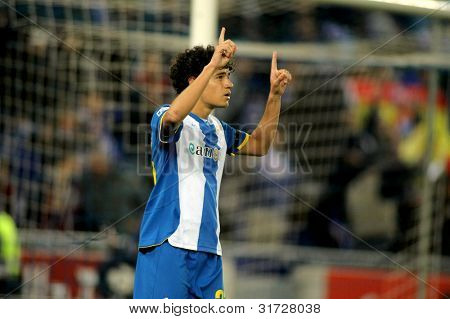 BARCELONA - MARCH 19: Philippe Coutinho of RCD Espanyol celebrating goal during a Spanish League match against Racing de Santander at the Estadi Cornella on March 19, 2012 in Barcelona, Spain