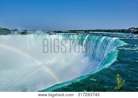 Beautiful Niagara Falls In Summer On A Clear Sunny Day With Rainbow, View From Canadian Side. Niagar