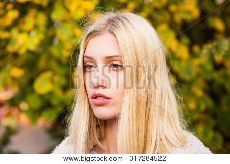 Enjoy Warmth. Woman Enjoy Sunny Day Outdoors. Pretty Woman Long Hair Nature Background. Fashion Conc