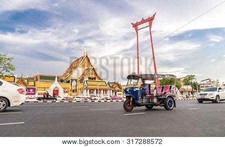 A Tuk Tuk Car On Street At The Giant Swing Or Sao Ching Cha The  Landmark Of Bangkok City. Thailand: