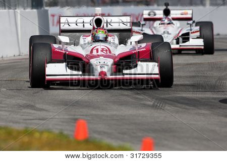 LONG BEACH - APRIL 17: James Jakes driver of the #18 Dale Coyne Racing Acorn Stairlifts Dallara Honda races during the IndyCar Series Toyota Grand Prix on April 17 2011 in Long Beach.