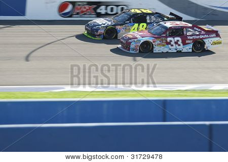 FONTANA, CA. - OCT 10: Sprint Cup Series driver Jimmie Johnson in the #48 car & Sprint Cup Series driver Clint Bowyer in the #33 car during the Pepsi Max 400 on Oct 10 2010 at the Auto Club Speedway.
