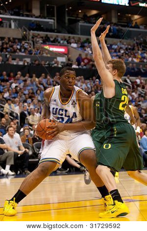 LOS ANGELES - MARCH 10: UCLA Bruins C Joshua Smith #34 & Oregon Ducks F E.J. Singler #25 during the NCAA Pac-10 Tournament basketball game on March 10 2011 at Staples Center.