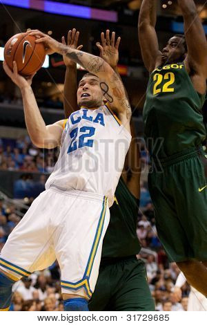 LOS ANGELES - MARCH 10: UCLA Bruins F Reeves Nelson #22 & Oregon Ducks G Teondre Williams #22 during the NCAA Pac-10 Tournament basketball game on March 10 2011 at Staples Center.
