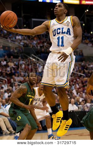 LOS ANGELES - MARCH 10: UCLA Bruins G Lazeric Jones #11 lays the ball up during the NCAA Pac-10 Tournament basketball game on March 10 2011 at Staples Center.