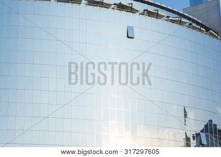 The Glass Facade Of A Modern Building. Mirror Glass. One Open Window. High Tech Style. Modern Archit