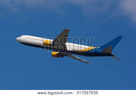 A Large White Passenger Plane Takes Off. Cargo And Passenger Transportation. Flight To The Summer Re