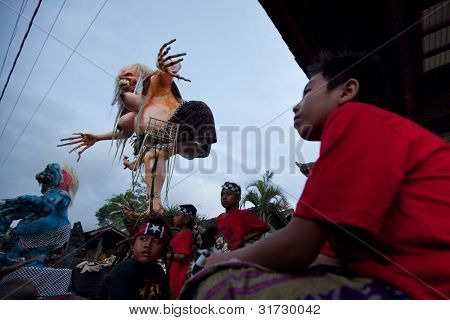 UBUD, BALI - MARCH 22: Unidentified child during the celebration of Nyepi - Balinese Day of Silence on March 22, 2012 in Ubud, Bali, Indonesia. The day following Nyepi is also celebrated as New year.