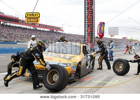 FONTANA, CA. - MARCH 27: Marcos Ambrose driver of the #9 DeWalt Ford pits during the NASCAR Sprint Cup Series Auto Club 400 on March 27 2011 at Auto Club Speedway.