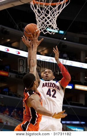 LOS ANGELES - MARCH 10: Arizona Wildcats F Jamelle Horne #42 & Oregon State Beavers F Devon Collier #44 during the NCAA Pac-10 Tournament basketball game at Staples Center in Los Angeles.
