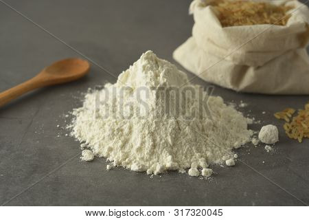 Rice Flour And Rice Over Dark Background. Gluten Free Flour For Healthy Pastry.