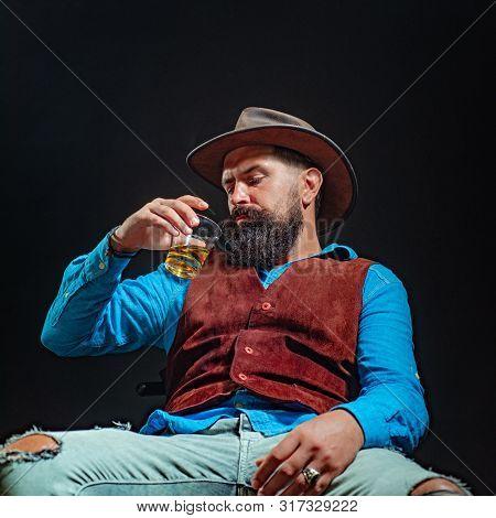 Man With Beard Holds Glass Brandy. Bad Habit - Alcohol Addiction. Addicting To Alcoholic Drink. Alco