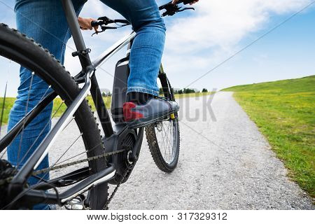 Man Riding Electric Mountain Bike In Alps