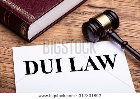 Black Dui Law Text On White Paper With Gavel And Law Book On Wooden Desk
