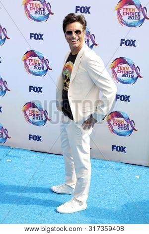LOS ANGELES - AUG 11:  John Stamos at the Teen Choice Awards 2019 at Hermosa Beach on August 11, 2019 in Hermosa Beach, CA