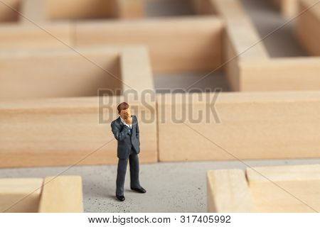 Businessman In The Maze As A Symbol Of Solving Problems And Finding A Good Way Out.