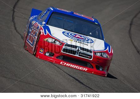 FONTANA, CA - MARCH 23:  A.J. Almendinger (22) brings his race car through turn 4 during a practice session for the Auto Club 400 race at the Auto Club Speedway in Fontana, CA on March 23, 2012