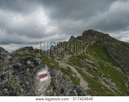 Red Trail Post Sign At Steep Hiking Path On Ridge Of Rohace Mountain To Peak Ostry Rohac. Sharp Gree