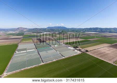 Aerial view of farm fields and the Santa Monica Mountains near Camarillo in scenic Ventura County, California.