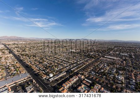 Aerial view of sprawling suburban Las Vegas homes and streets in Southern Nevada.