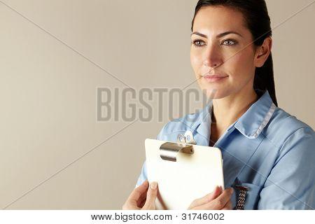 UK nurse holding clipboard