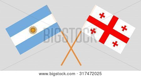 Georgia And Argentina. Crossed Georgian And Argentinean Flags. Official Colors. Correct Proportion.