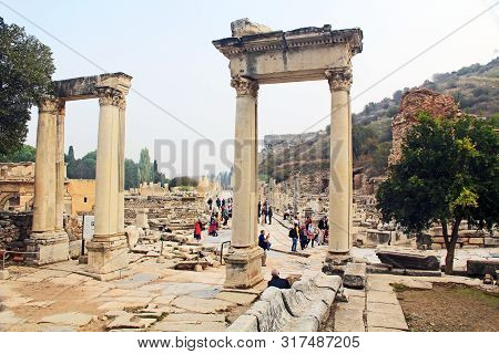 Ephesus, Izmir, Turkey - October 19, 2018:        Tourists By The Archaeological Ruins Of The Gate O