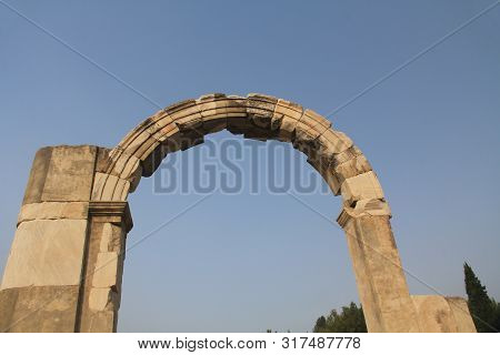 Doorway Arch Along The Marble Road In The Ancient City Ruins Of Ephesus, Turkey Near Selcuk With Blu