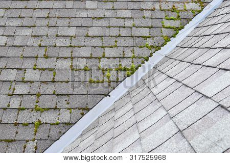 Different Two Parts Of Grey Bitumen Asphalt Shingles Roof One Part Overgrown With Green Moss Other C