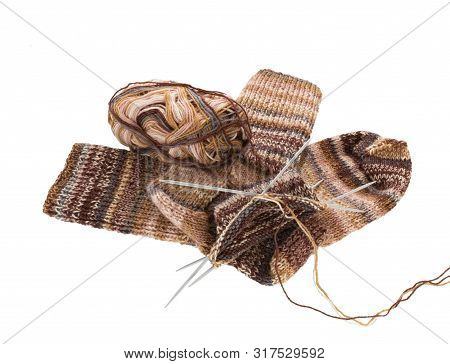 Knitting Socks And Knitting Needle Isolated On White Background. Socks Winter Warm Wool Knit. Knitte