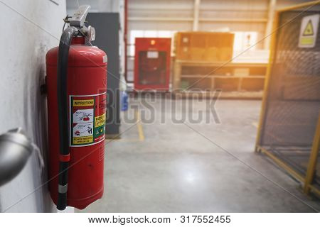 Dry Chemical Fire Extinguisher Were Mounted On The Walls Of  Working Area.