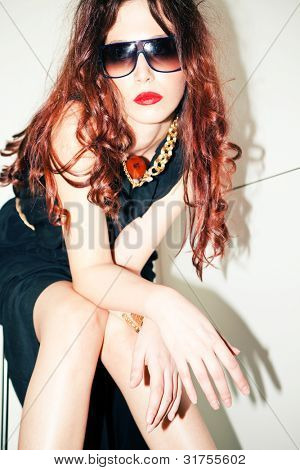 modern redhead young woman portrait with sunglasses, indoor shot