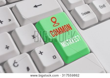 Text sign showing Common Mistakes Question. Conceptual photo repeat act or judgement misguided making something wrong White pc keyboard with empty note paper above white background key copy space. poster