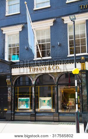 London, Uk - August 13, 2019: Logo Of The Tiffany And Co Brand On The Old Bond Street At Sunset, Maj