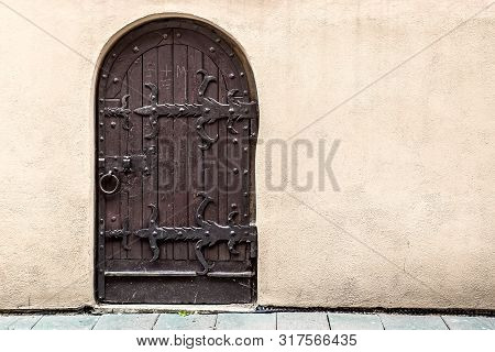 Mediaeval Wooden Brown Door With Forged Elements