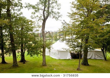 A tent set up for an outside wedding reception or other function