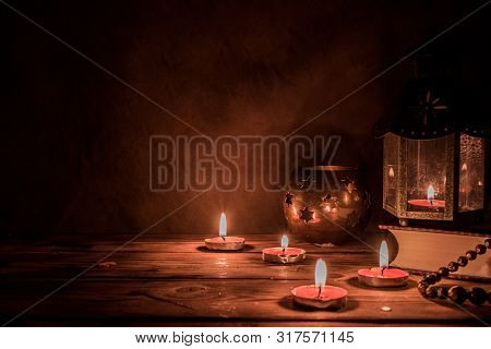 Arabic Lantern With Candle At Night For Islamic Holiday. Muslim Holy Month Ramadan. The End Of Eid A