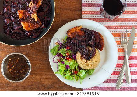 Coq Au Vin Chicken. Braised With Wine - French. French Dish Of Chicken Braised With Wine. The Dish I